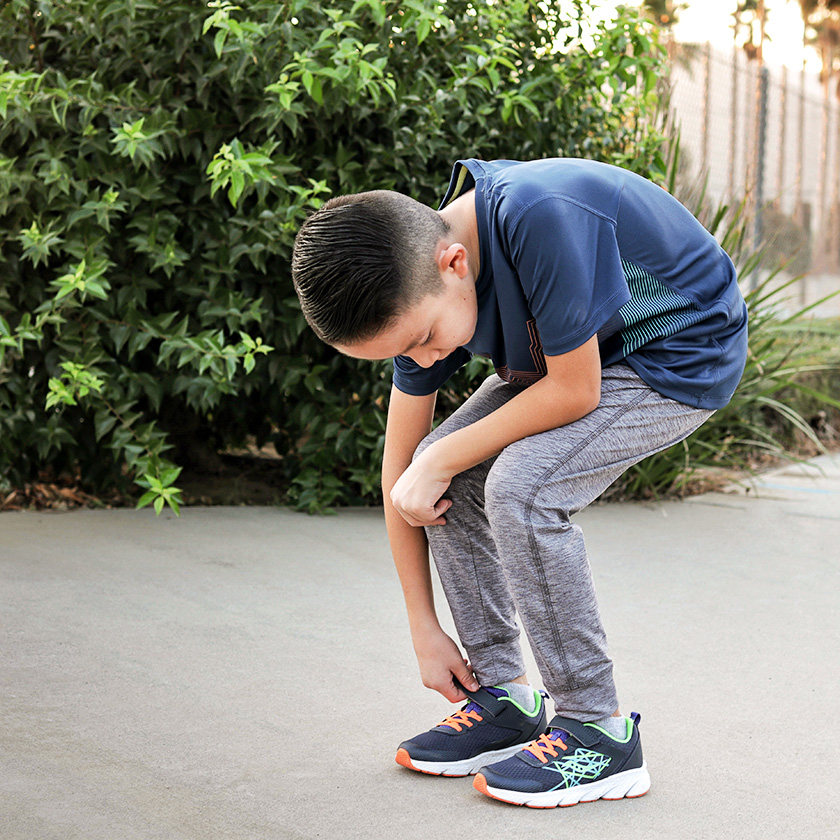Young kids wearing Saucony shoes.