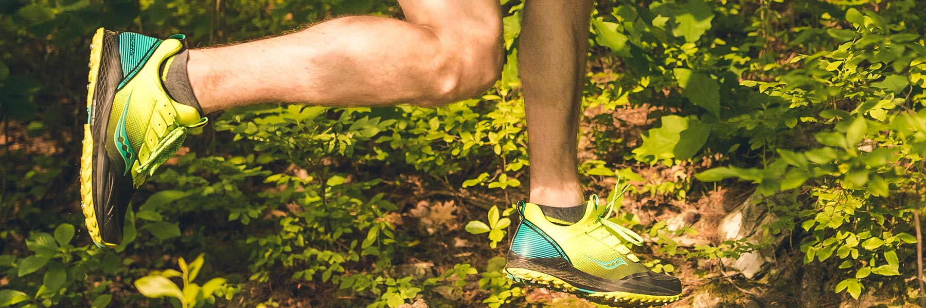 Mad River TR Shoe running with grass and dirt flying behind