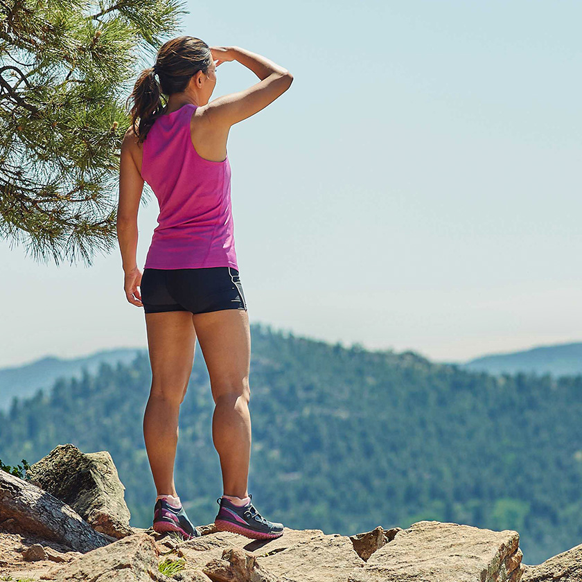 Girl in running shoes at the top of the hill.