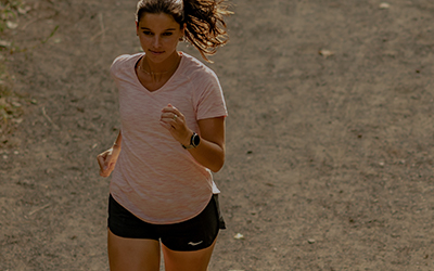 Person running in Saucony shoes and apparel.