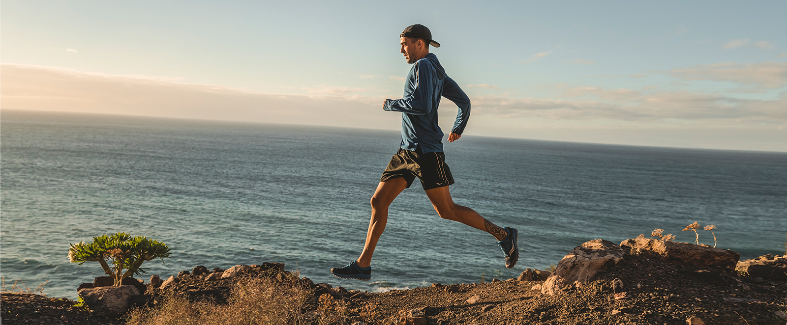 A man running along rocks