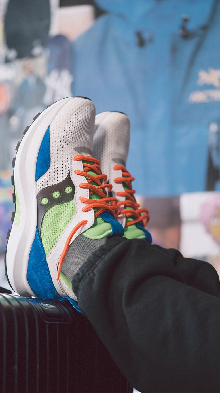 Close up of persons feet wearing Saucony Abstract Jazz shoes.