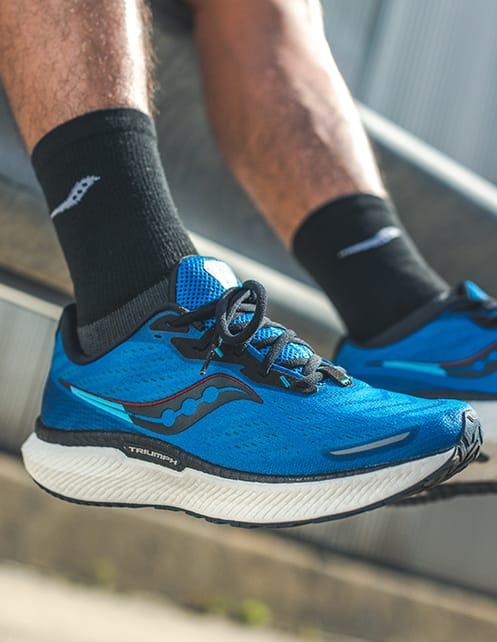 Closeup of blue Saucony Triumph 19 shoes.