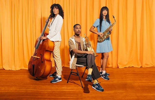 A band posing with their instruments and Suacony Jazz shoes.