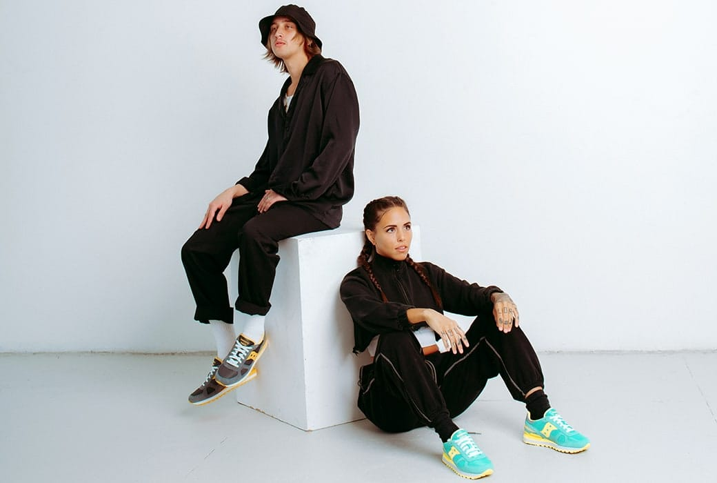 Two people possing with Saucony Shadow shoes.
