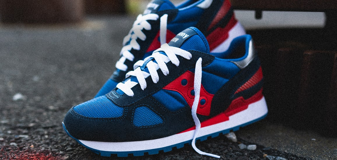 Blue and red Saucony Original Shadow shoes.