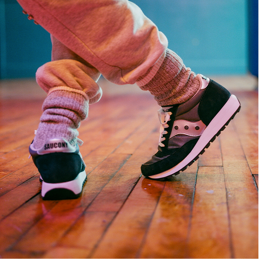 Person dancing with Saucony Jazz.
