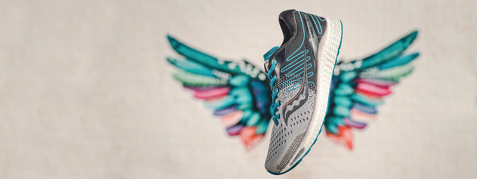 Freedom 3 shoe in front of colorful bird wings art.