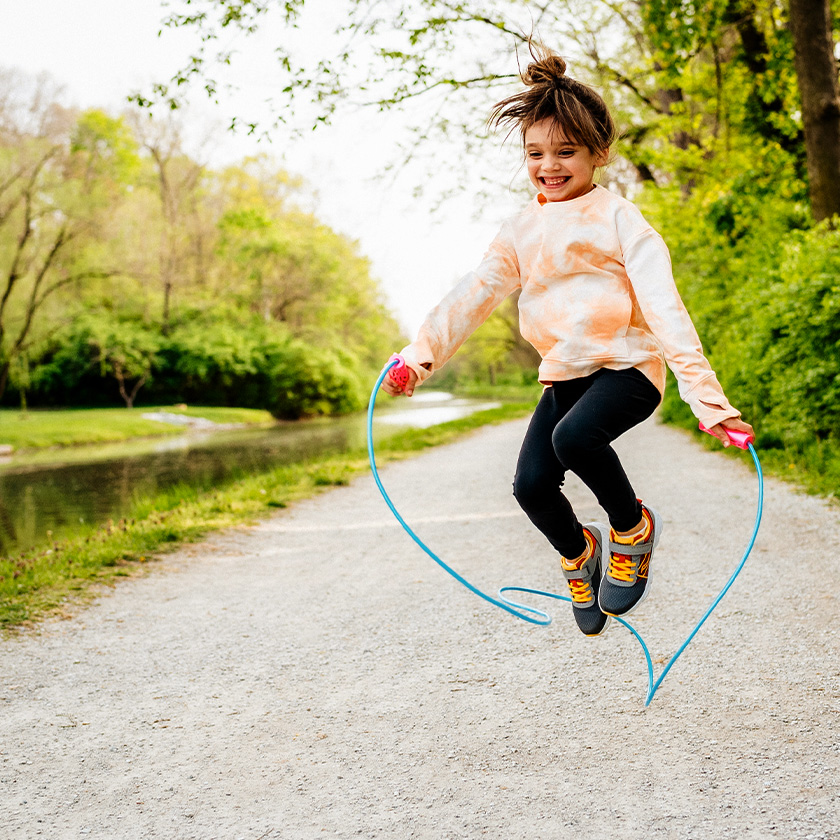 Kid jumping rope and loving it.