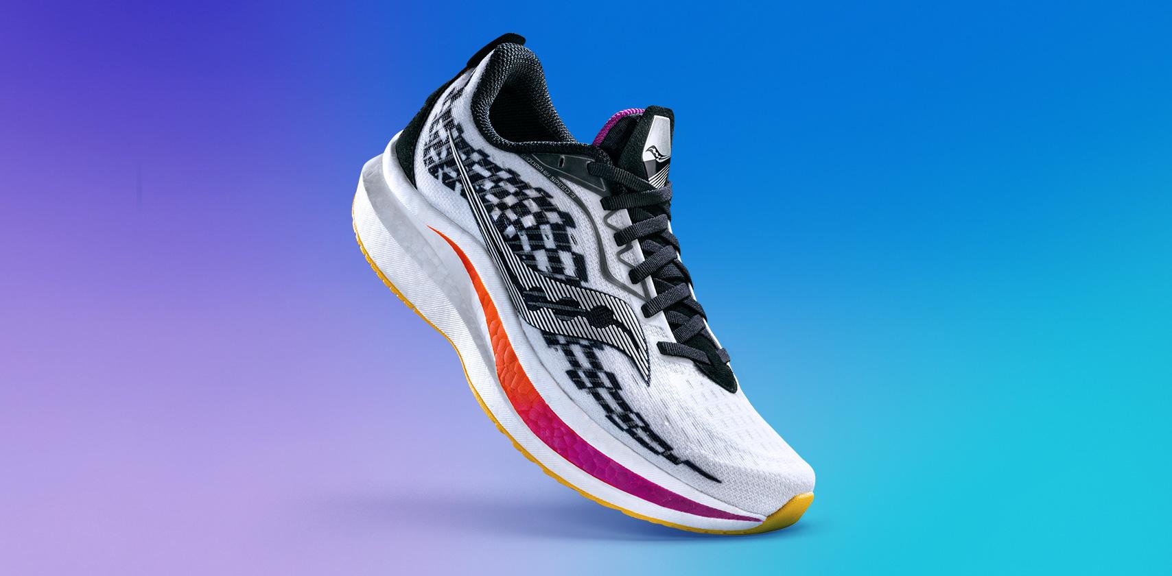 Black & white Endorphin Speed 2 with orange & purple swoosh.