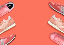 Saucony Originals shoes on a peach colored background