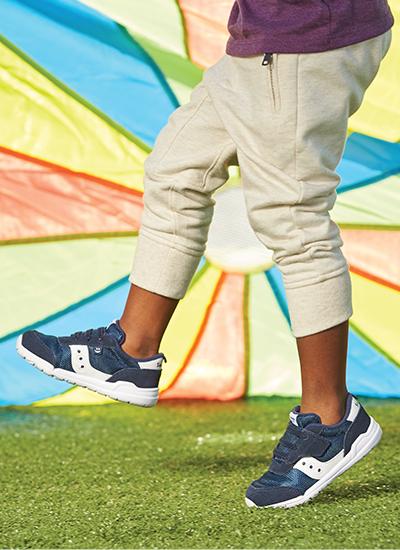 A kid dances around wearing Jazz shoes.