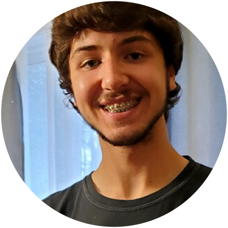 Profile of Zeke smiling.