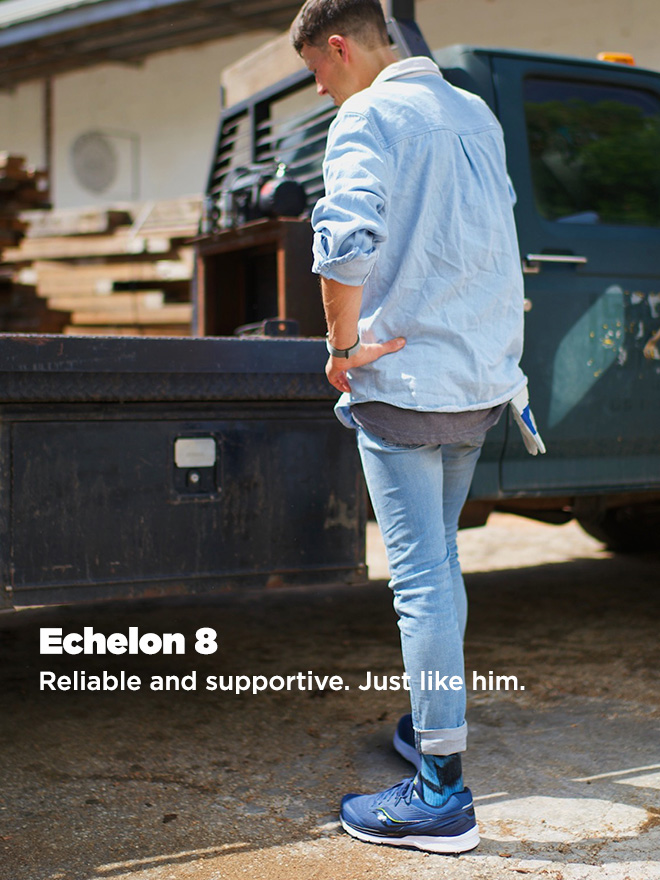 Person wearing Echelon 8 shoes next to an old blue flatbed truck.