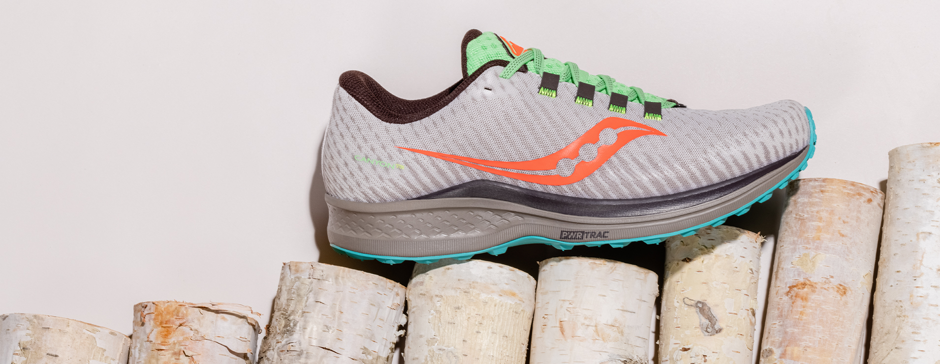 Saucony Canyon TR shoe on birch logs.