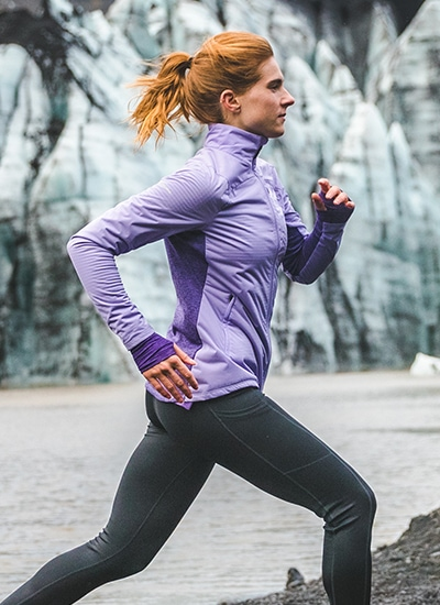 Woman running in the winter wearing Saucony apparel
