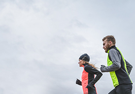 A man and woman running in flashy new apparel.