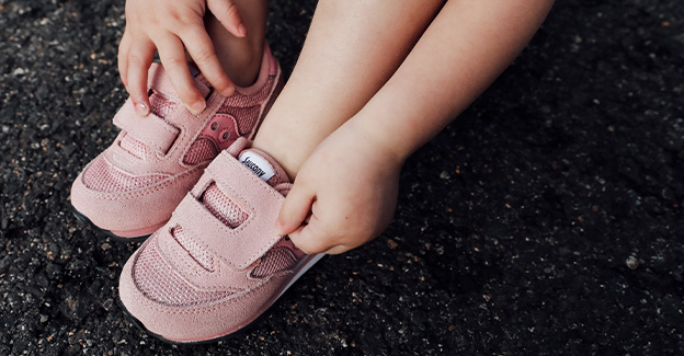 A close up of Sacuony easy on and off kids shoes.