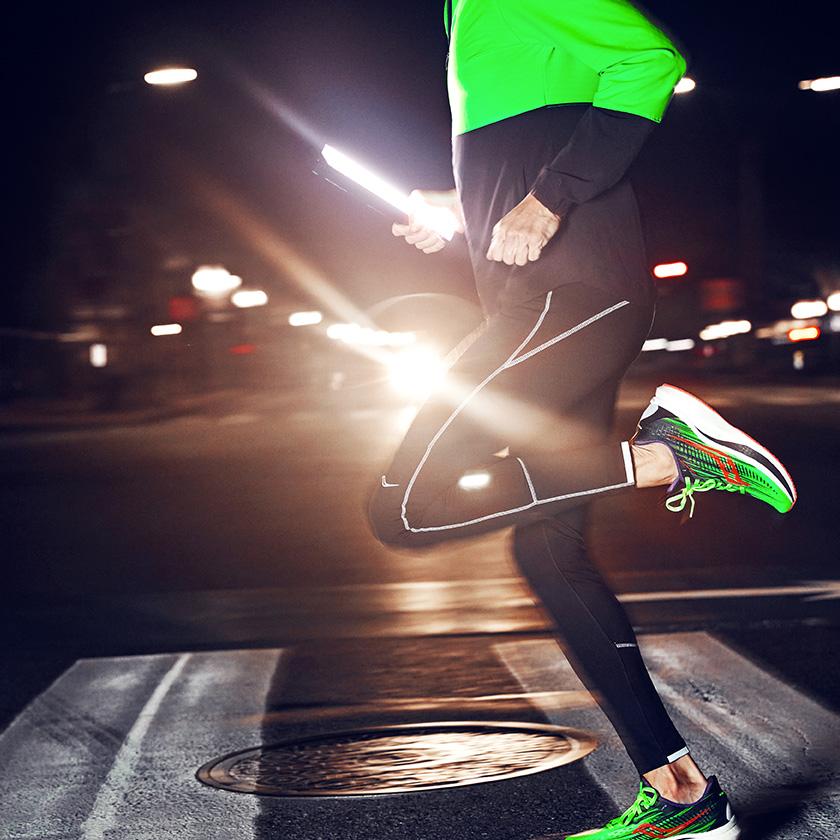 Person running at night wearing Vizipro shoes.