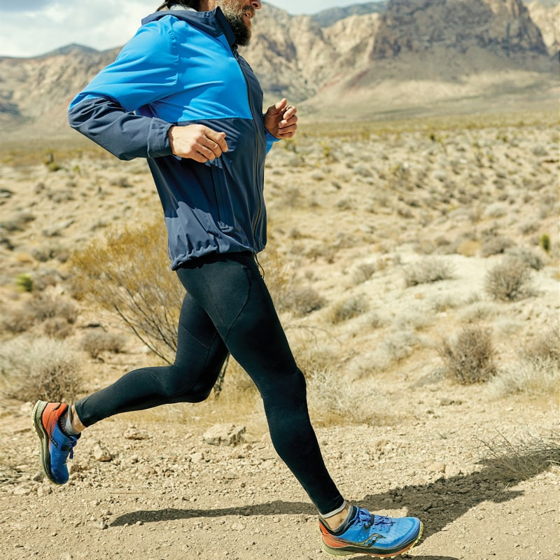 A man running in the dessert.