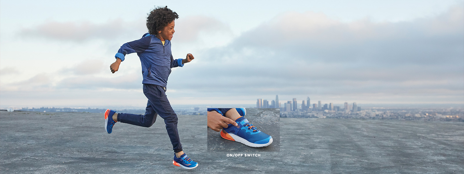 Child running with a city in the background, with a close up of his shoes and their on/off 'flash' switch