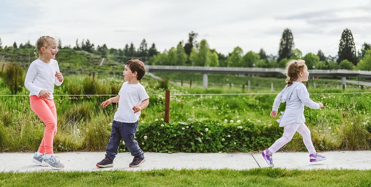 2 Kids playing on a path.