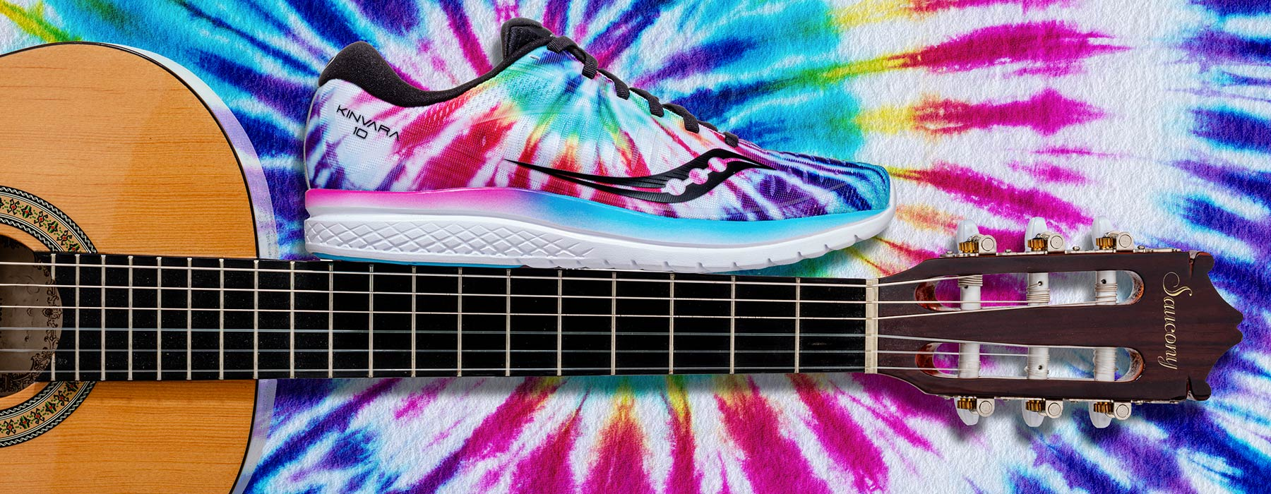 Tie Dyed Kinvara 10 on the neck of an acoustic guitar.