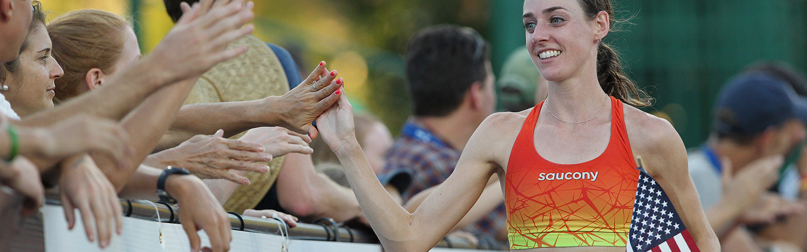 Woman giving high fives at the end of a race
