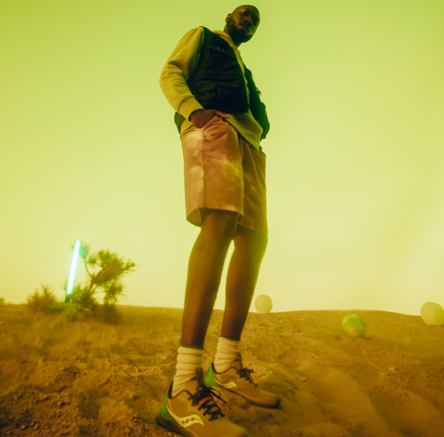 Man chilling on what appears to be an alien planet.
