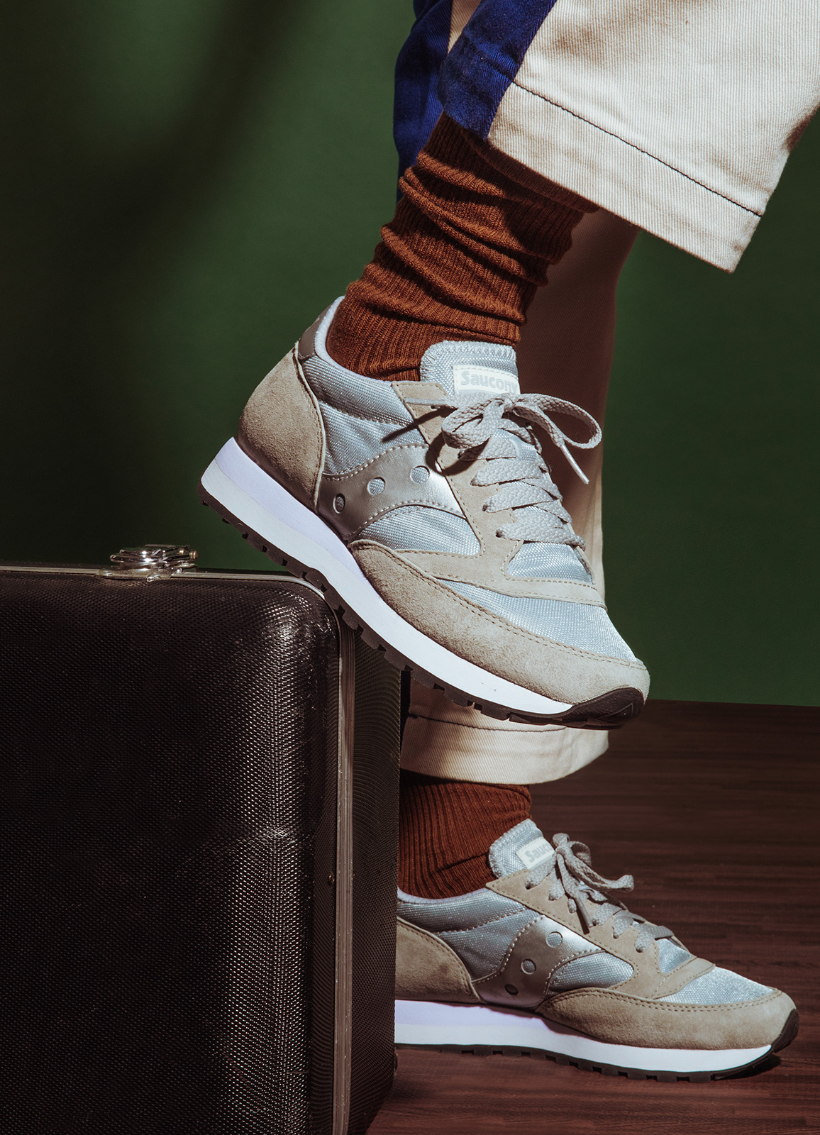 White and silver Saucony Jazz shoes.