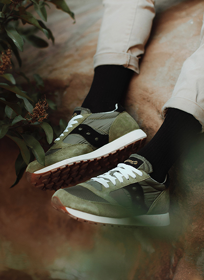 Relaxed pair of legs wearing Saucony Jazz Original Shoes