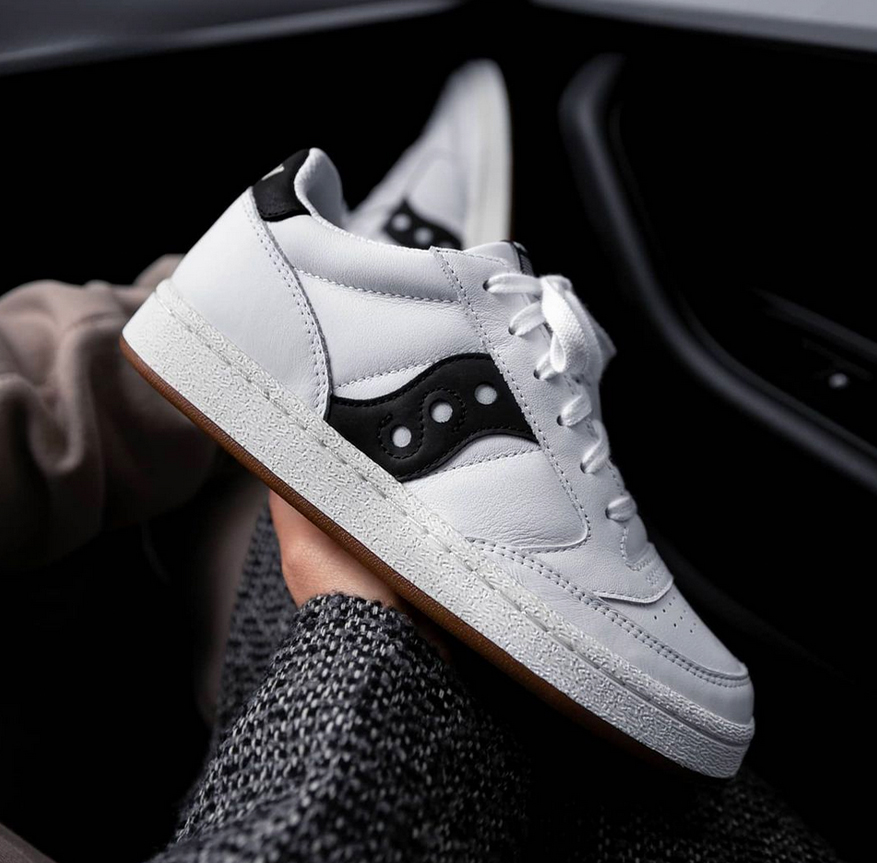 Close up of a white with black trim shoe.