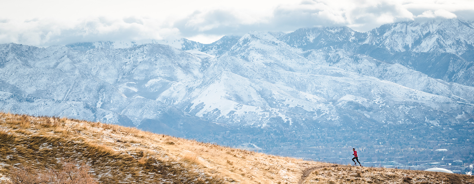 A solitary runner in the mountains.