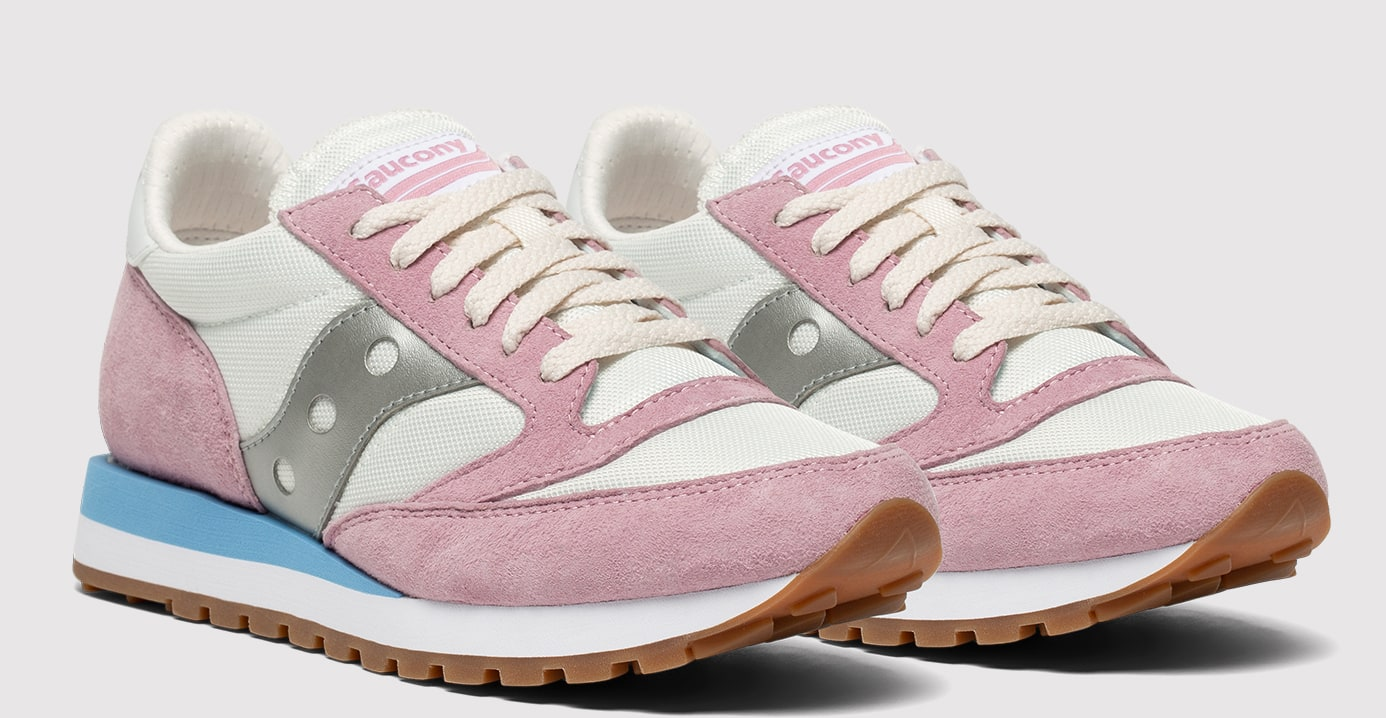Pair of Jazz 81 shoes in jet stream, dawn pink, and grey and colors.
