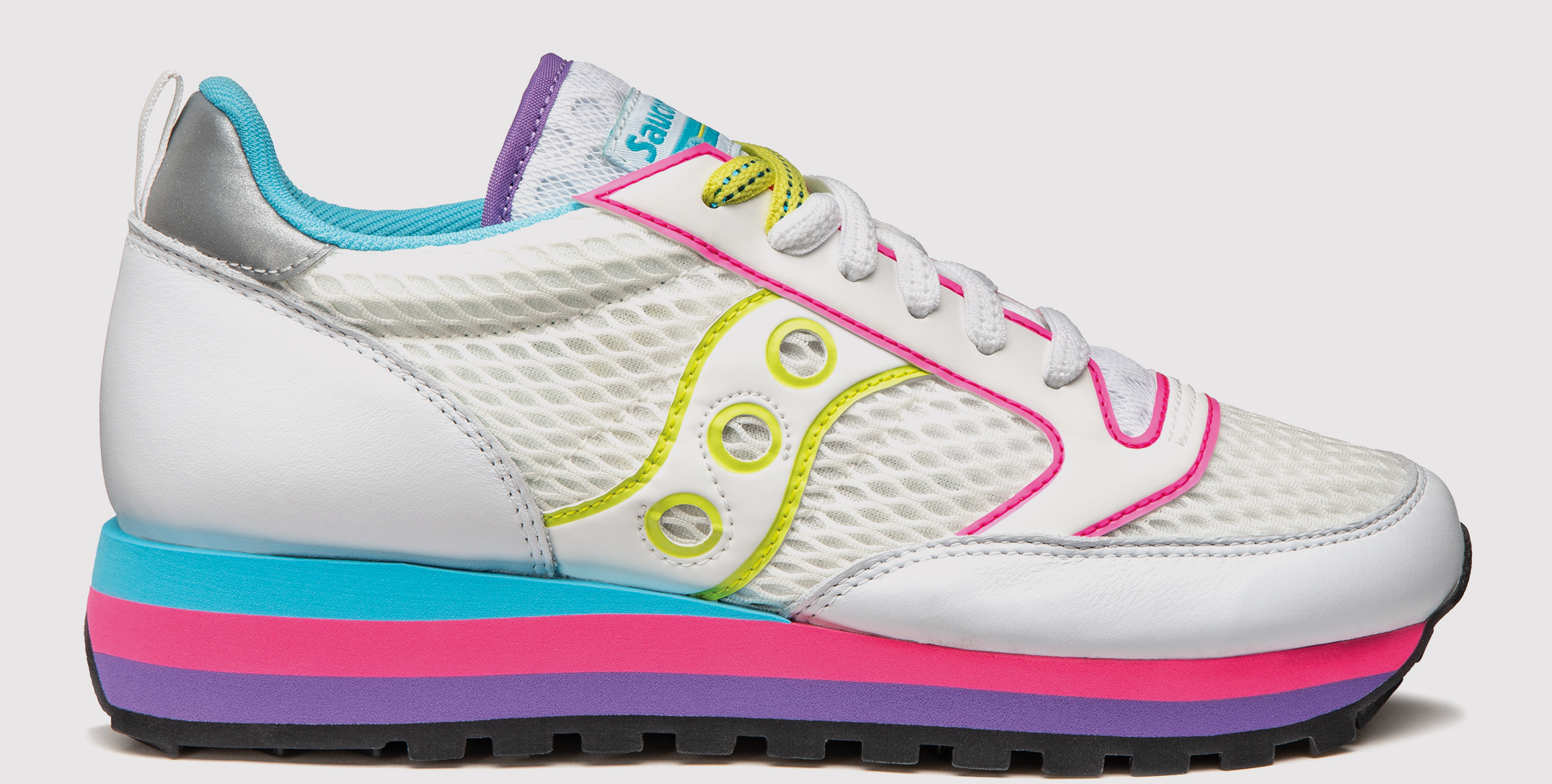 Pair of Jazz Triple shoes in white and neon yellow, pink, blue and purple colors.