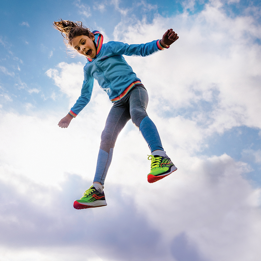 Kid jumping and having fun wearing Vizipro shoes.