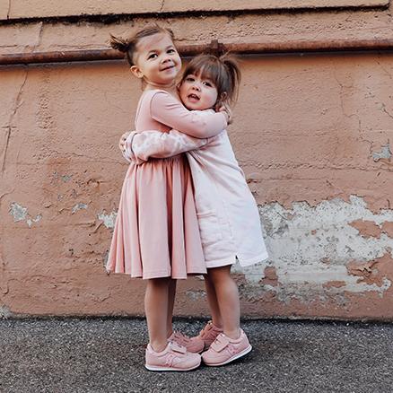 Kids hugging.