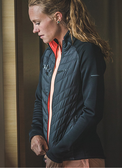 Woman getting ready to run in the winter wearing Saucony apparel