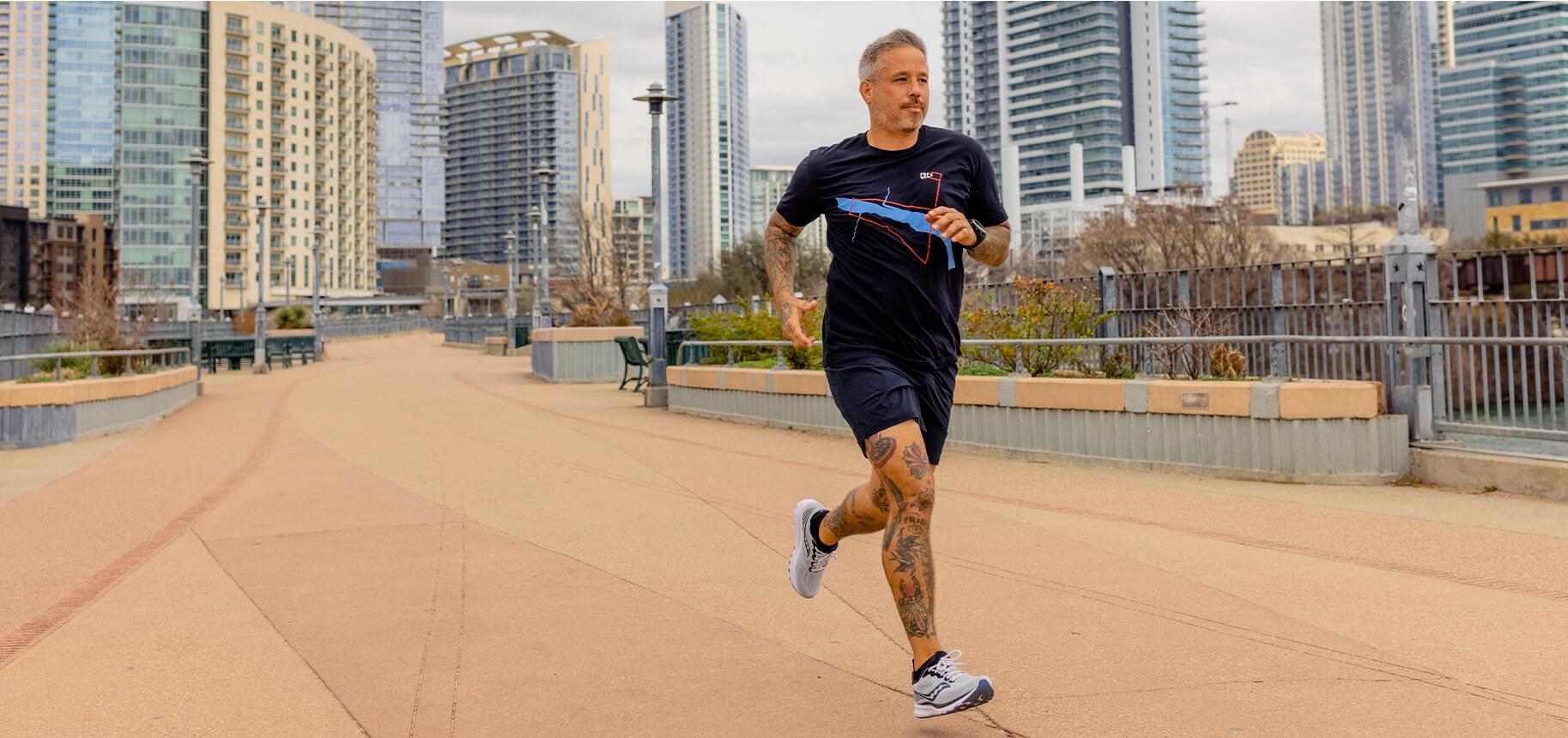Phillip Speer running on an urban trail.