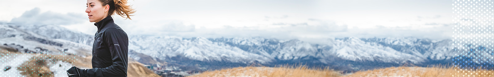 Woman running in the mountains in winter.